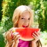 Children blond little girl eating watermelon slice in forest — Stock Photo #6214137