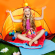 Children girl playing with balls inside camping tent — Stock Photo