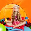 图库照片: Children girl inside camping tent relaxing with yoga