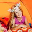 Children fashion little girl lying indoor of camping tent — Stock fotografie