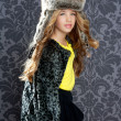 Children fashion girl winter leopard coat and fur hat - Stock Photo
