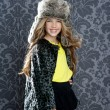 Children fashion girl winter leopard coat and fur hat - Zdjęcie stockowe