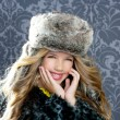 Children fashion girl with winter leopard coat and fur hat — Stock Photo