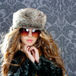 Children fashion blond girl with fur winter coat and hat — Stock Photo