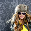 Children fashion blond girl with fur winter coat and hat — Stock fotografie