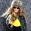 Stock Photo: Children fashion blond girl with fur winter coat and hat
