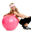 Children gym yoga girl with pilates pink ball — Stock Photo #6215177