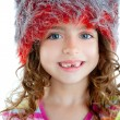 Stock Photo: Children little girl with winter fur cap orange and silver