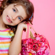 Stock Photo: Children girl holding fashin spring pink flowers bag