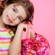 Children girl holding fashin spring pink flowers bag - Stock Photo