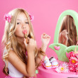 Children fashion doll little girl lipstick makeup pink vanity — Stock Photo