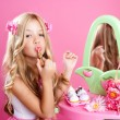 Children fashion doll little girl lipstick makeup pink vanity - Stock Photo
