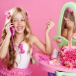 Children fashion doll blond girl talking mobile phone — Stock Photo