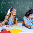 Classroom with two kids students cheating on test - Foto de Stock  