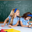 Classroom with two kids students cheating on test - Stock Photo