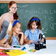 Kids students with nerd teacher woman at school — Stock Photo #6218116