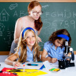 Kids students with nerd teacher woman at school - Stock Photo