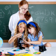 Royalty-Free Stock Photo: Kids students with nerd teacher woman at school