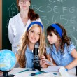 Kids students with nerd teacher woman at school — Stock Photo
