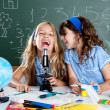 Happy laughing kids student girls at school classroom — Stockfoto