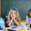 Bored student kids at school classroom in desk — Stock Photo #6218532