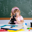 Children little girl at school classroom with microscope — ストック写真