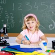 Children little girl at school classroom with microscope — Stockfoto #6218758