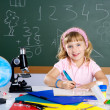 Stock Photo: Children little girl at school classroom with microscope