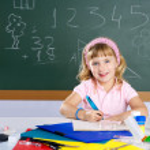 Happy similing children student girl at school — Stock Photo