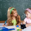 Kids students in classroom helping each other — Stock Photo #6218933