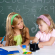 Kids students in classroom helping each other — Stock Photo #6219021