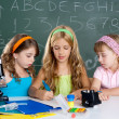 Stock Photo: Kids group of student girls at school classroom