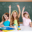 Foto Stock: Clever kids student group at school classroom