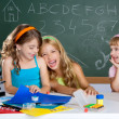 Stock Photo: Happy laughing kids student girls at school classroom