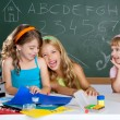 Happy laughing kids student girls at school classroom — Stock Photo #6219605