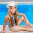 Blond children girl sittin in swimming pool border — Stock Photo