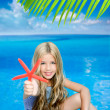 Children blond girl in summer vacation tropical beach — Stock Photo