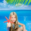 Children blond girl in summer vacation tropical beach — Stock Photo #6219919