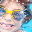 Stock Photo: Children girl funny underwater with goggles