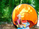 Camping children girl with hat in forest tent outdoor — Stock Photo