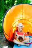 Camping children girl in tent eating watermelon slice — Stock Photo