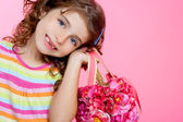 Children girl holding fashin spring pink flowers bag — Stock Photo