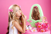 Children fashion doll little girl lipstick makeup pink vanity — Stockfoto