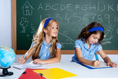 Classroom with two kids students cheating on test — Stock Photo