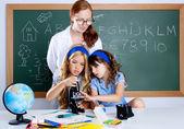 Kids students with nerd teacher woman at school — Stock Photo