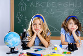 Bored student kids at school classroom in desk — Stock Photo