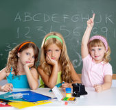Boring sad student with clever children girl raising hand — ストック写真
