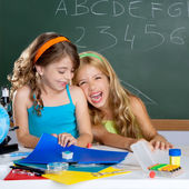 Happy laughing kids student girls at school classroom — Stock Photo