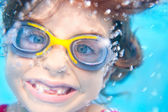 Children girl funny underwater with goggles — Stok fotoğraf