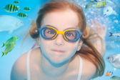 Children girl underwater goggles swimming underwater — Stock Photo